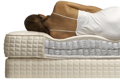 Back of a woman sleeping on a mattress