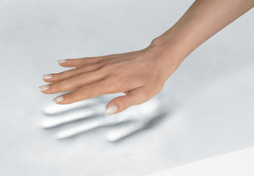 Hand on a foam mattress