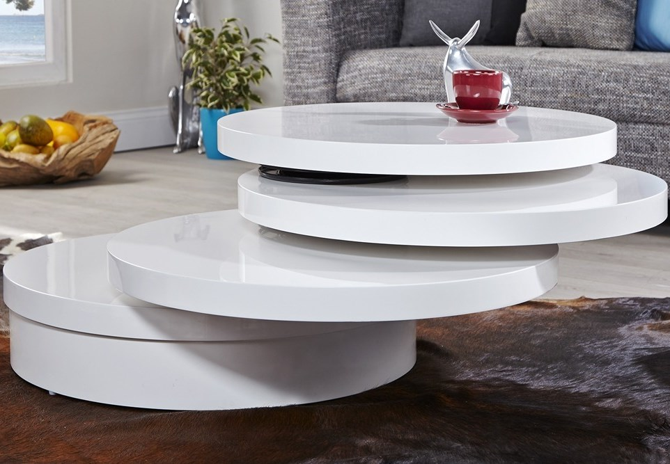 Coffee table with pivoting trays