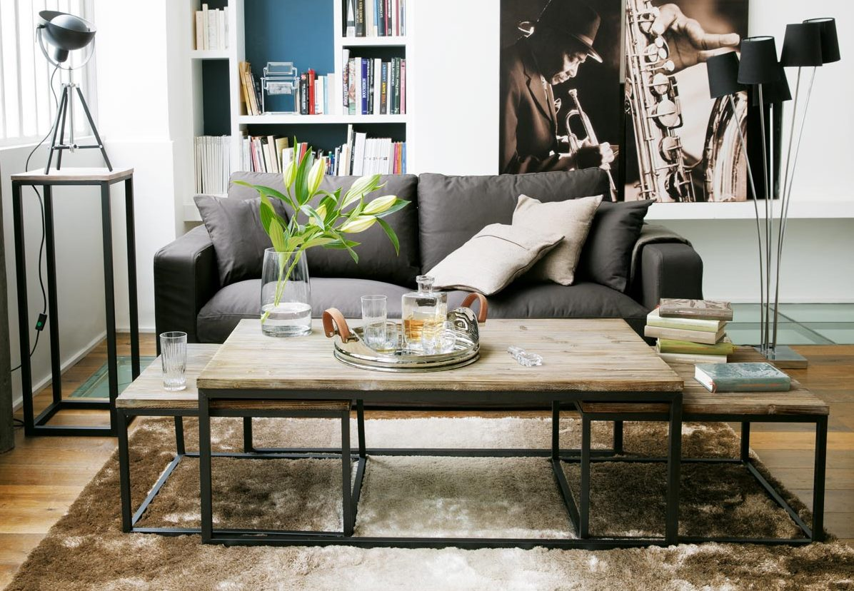 Coffee table with integrated nesting tables