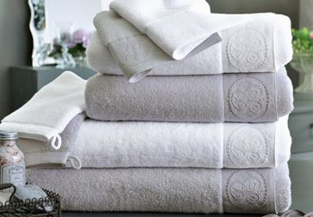 Set of towels in a bathroom in neutral colors