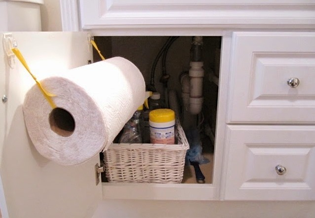 DIY paper towel holder inside a kitchen cupboard