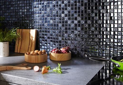Dark glass mosaics on a kitchen splashback