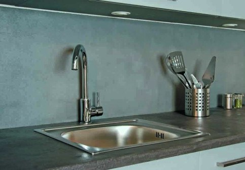 Polished concrete coating on a kitchen splashback