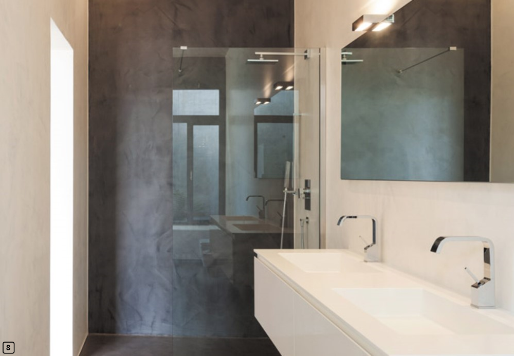 Walk-in shower with polished concrete flooring