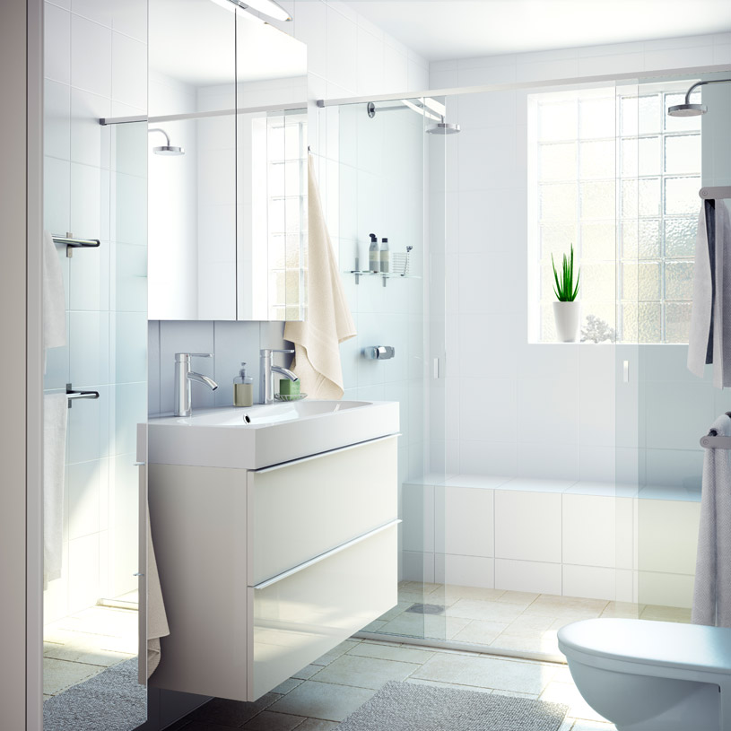 Uncluttered bathroom with natural light and light coloured walls