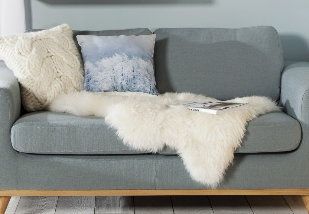 A sheepskin on a sofa