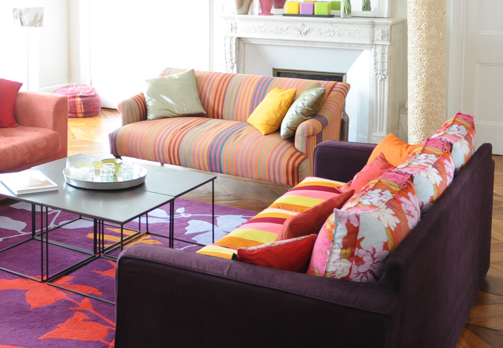 Mixing patterns by style in a living room with stripes and floral designs