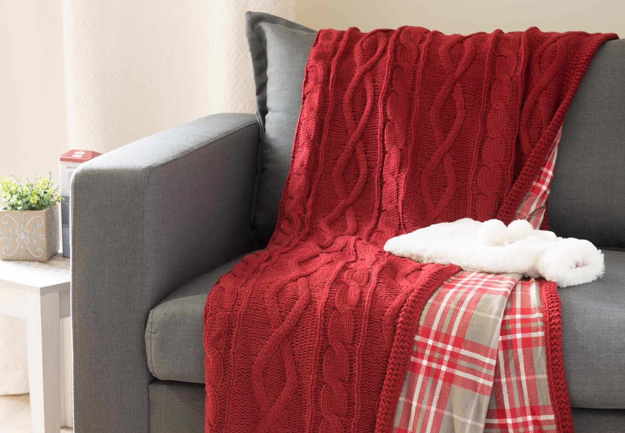 Red mohair plaid throw on a couch