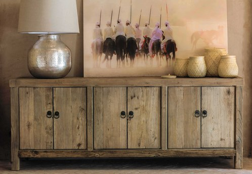 Polished wood sideboard with a lamp and a painting