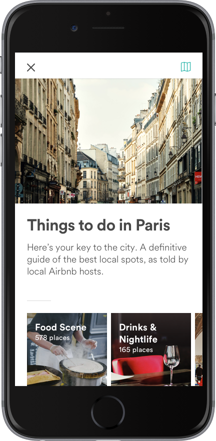 Smartphone screen with Airbnb Guidebooks for neighborhood
