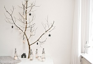 Small black stars on a branch for christmas decoration