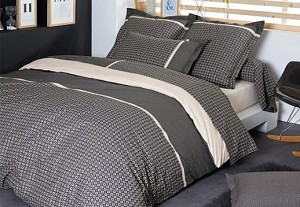 Bed with grey percal cotton bedlinen