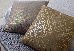 Two brown cushions with golden patterns